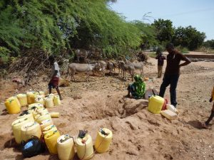 Community residents in Garbatulla  Isiolo County around a dried up water point