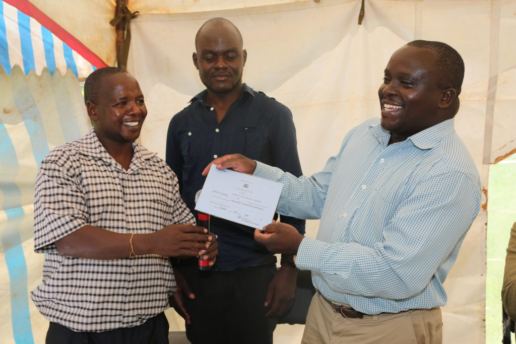 Antony Wahome, Chairman of Busia Agro Dealers Association, Andrew Netia, the Secretary, and Alison Mugendi, the Ag. Director of Agriculture, Busia County.