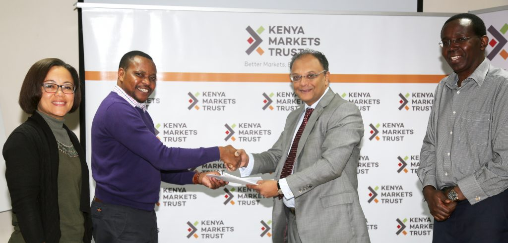 Mugo Karikuki of WSUP and Kevit exchange signed agreement documents