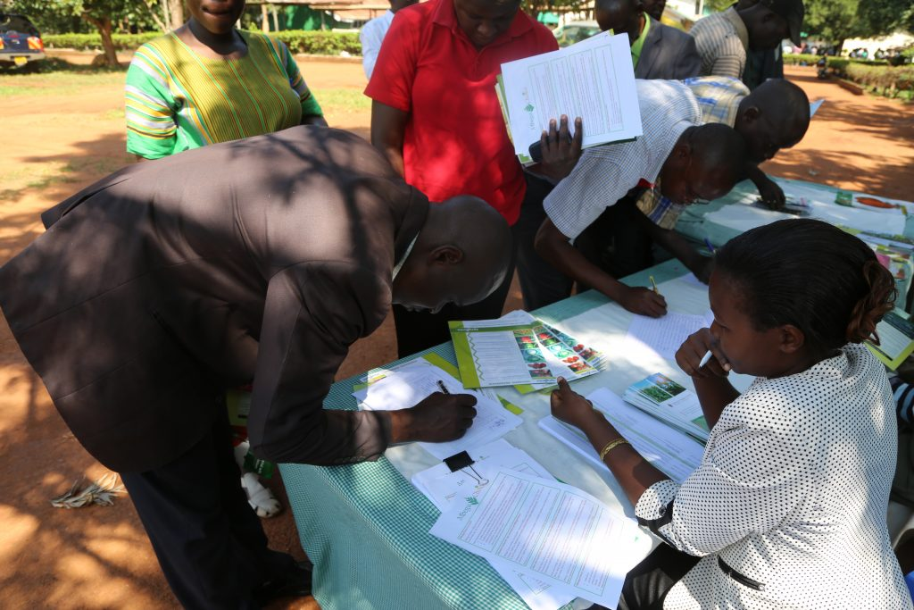 Participants register for the Busia County Agribusiness stakeholders forum at the Busia Agricultural Training Centre. The Busia Agro dealers Association was officially launched at the workshop.